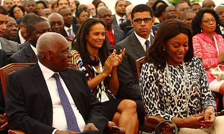 José Eduardo dos Santos, Angola's president, left, and daughter Isabel dos Santos in the second row